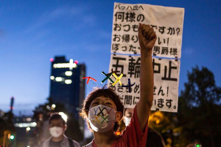 Hoewel het merendeel van de Japanners niet op de Spelen zat te wachten, gingen er maar weinig demonstranten de straat op.  Beeld Getty Images