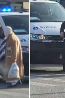 La belle image de la semaine: un policier bruxellois bloque la circulation pour aider une dame à traverser
