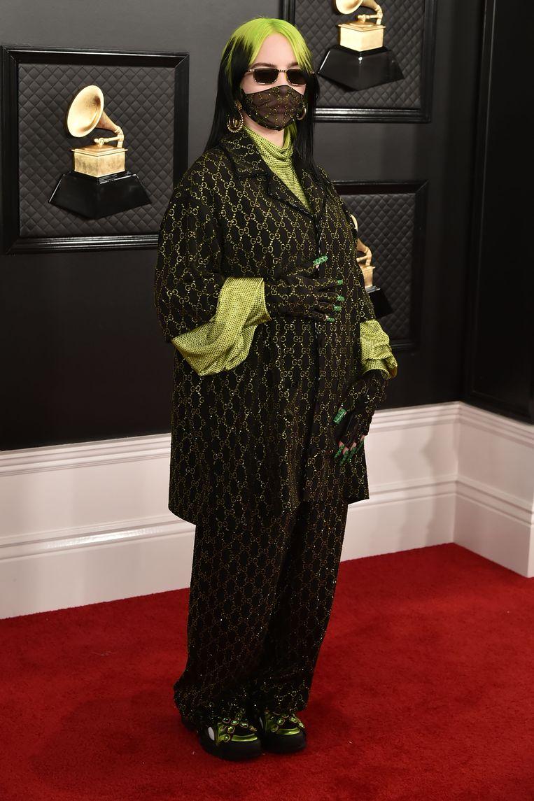 Billie Eilish met mondkapje op de rode loper van de Grammy-uitreiking in januari. Beeld Patrick McMullan via Getty Image