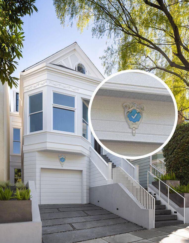 Foto van de parodie-website die huizenbezitters blauwe vinkjes aanbiedt Beeld Blue Check Homes
