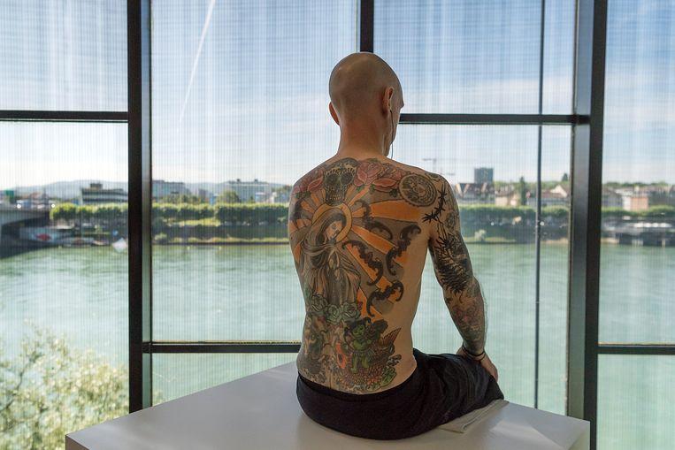 'Tim' uit 2006, een van Wim Delvoyes meest controversiële en gemediatiseerde kunstwerken. Als Tim sterft, dan gaat zijn huid naar de verzamelaar die er 150.000 euro voor betaald heeft op een veiling.  Beeld EPA