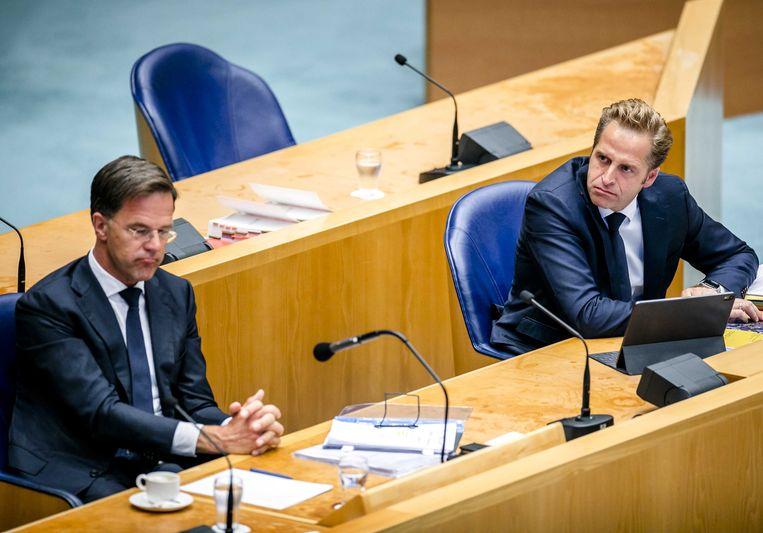 Premier Mark Rutte en minister Hugo de Jonge tijdens het debat over de ontwikkelingen rondom het coronavirus. Beeld ANP