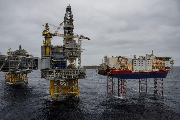 Door het verlies met beleggingen in olie gaat het erom spannen of de pensioenen van PFZW volgend jaar worden verlaagd of niet.  Beeld Bloomberg via Getty Images