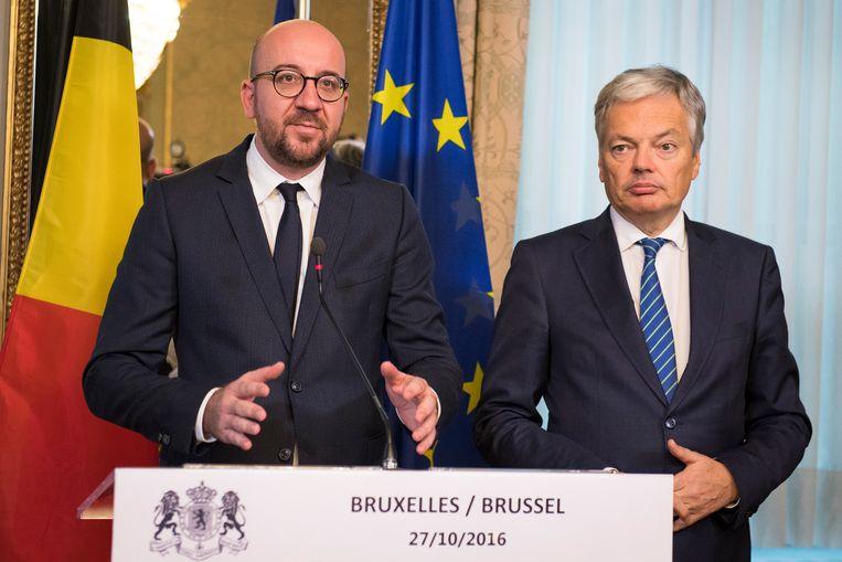 Premier Charles Michel en minister van Buitenlandse Zaken Didier Reynders stelden het akkoord vanmiddag voor. Beeld BELGA