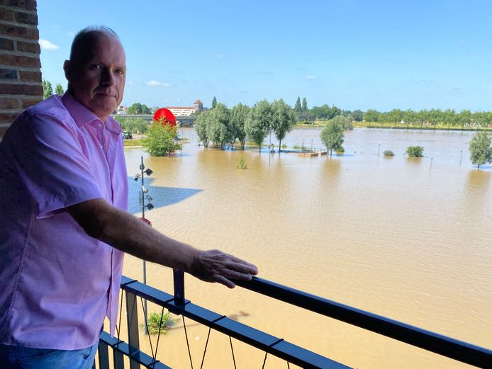 Gé Gijsen normally overlooks the marina and a park, but now the water of the Maas reaches his front door.