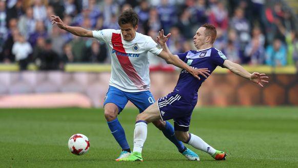 Vossen en Trebel in actie tijdens Anderlecht-Club Brugge.