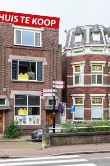 Deze moderne woning in een oud bankkantoor heeft nog steeds een loket (maar de geldkluis is er niet meer)