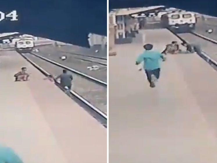 Heldhaftige man redt kind (6) net op tijd van het spoor in India