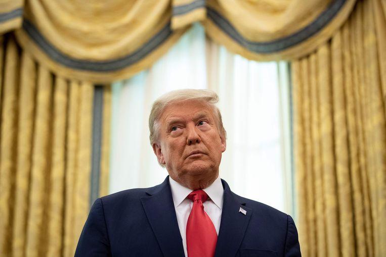 De Amerikaanse president Donald Trump vrijdag tijdens een ceremonie in het Witte Huis. Beeld AFP