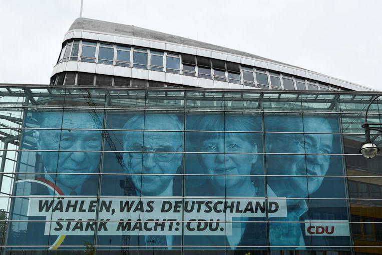 Verkiezingsposter van het CDU in Berlijn.  Beeld REUTERS