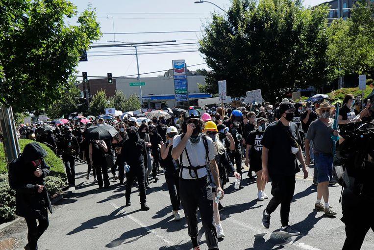 Demonstranten marcheren door Seattle. Beeld AP