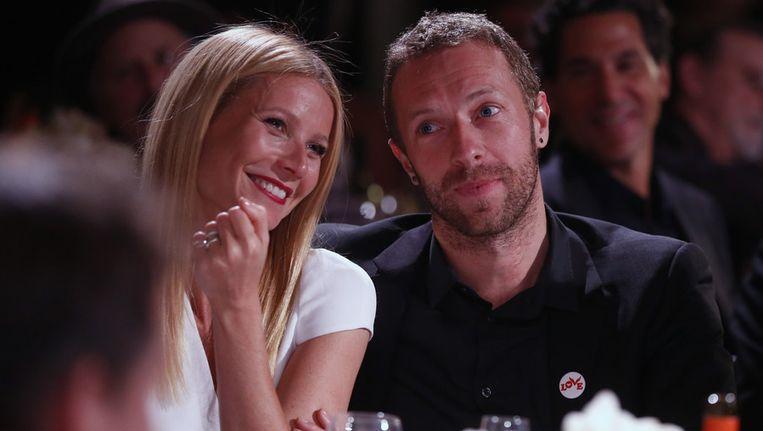 Gwyneth Paltrow en Chris Martin tijdens het HELP HAITI HOME benefiet in Beverly Hills. Beeld AP