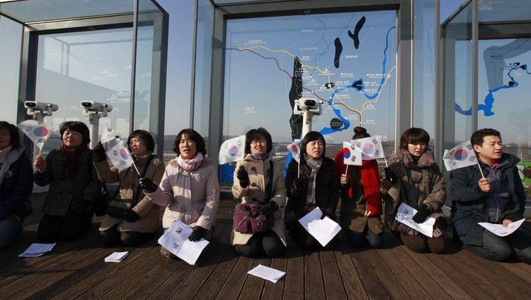 Zuid-Koreaanse Christenen bidden voor vrede met Noord-Korea, vandaag. Beeld reuters