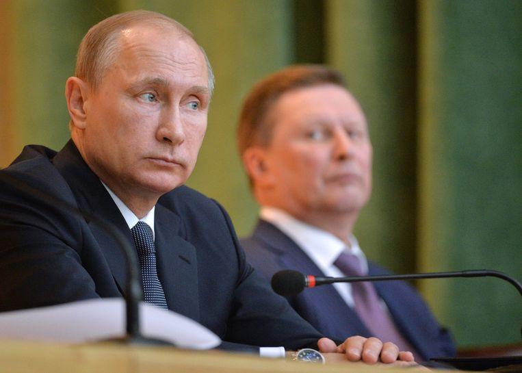 President Poetin met Sergej Ivanov in de achtergrond. Beeld EPA