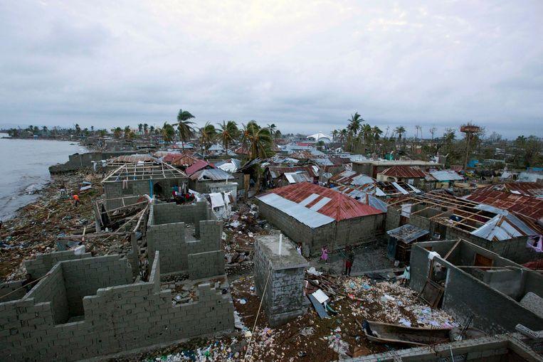 Huizen in puin in Haïti. Beeld AP