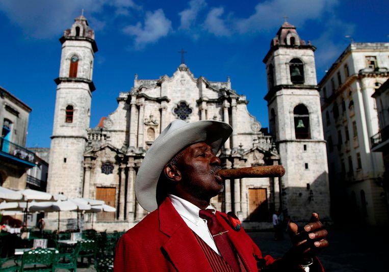 Een straatartiest in Havana. Beeld AP