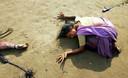 In Indiase vrouw rouwt na de tsunami om de dood van een gezinslid. In 2004 al viel de term BBB.