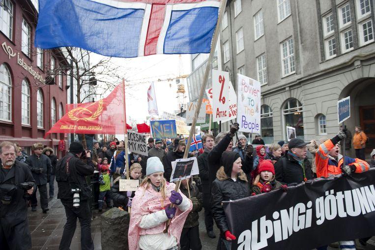 Een demonstratie in de straten van Reykjavik vanwege de toenmalige crisis. Beeld AFP
