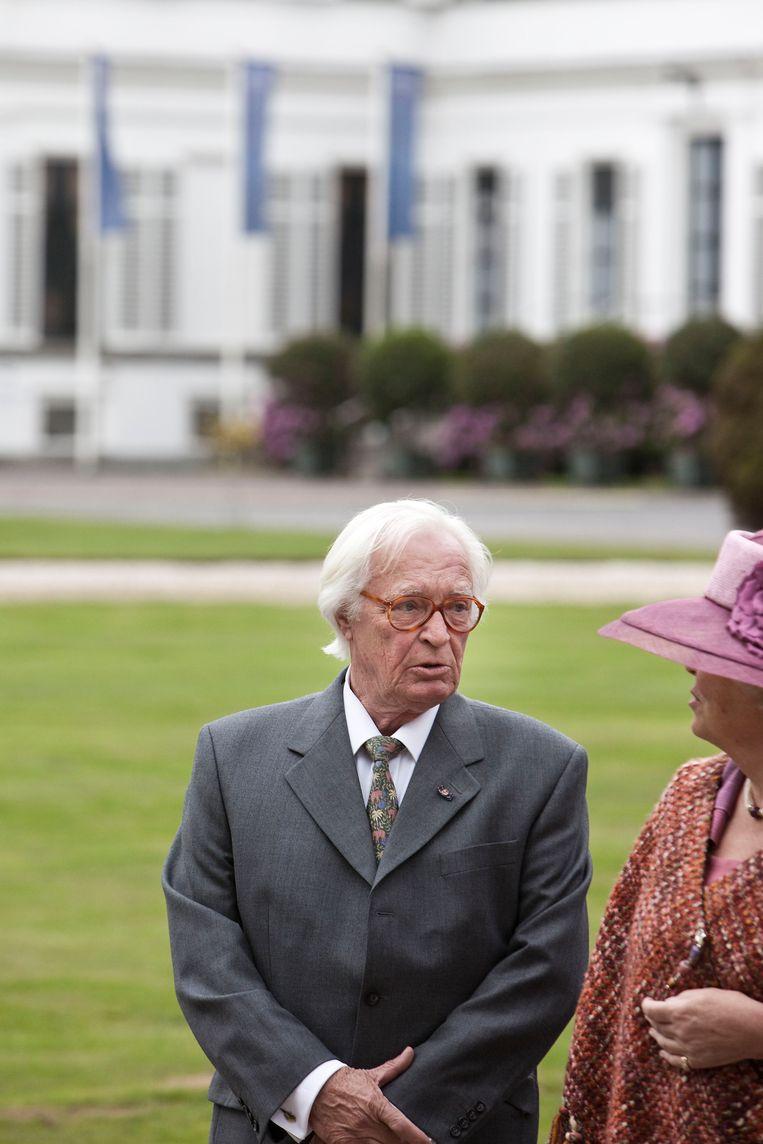 Kees Verkade in gesprek met voormalig koningin Beatrix, hier op de foto in 2009. Beeld Martijn Beekman