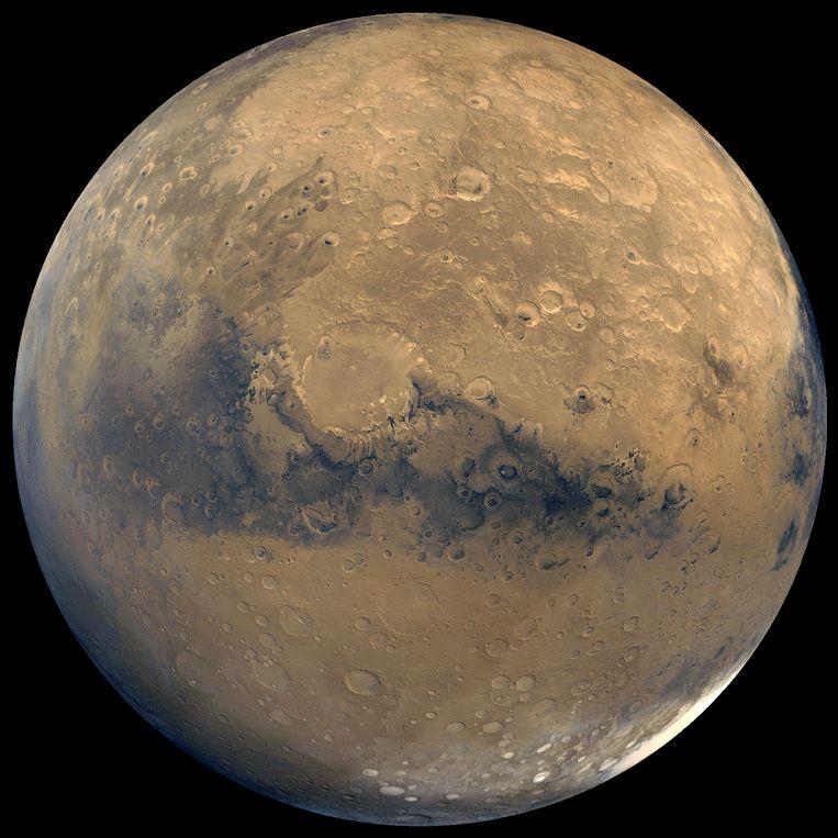 Een foto van de planeet Mars die samengesteld werd uit foto's van Viking Orbiter, een ruimtetuig van NASA. Beeld AP
