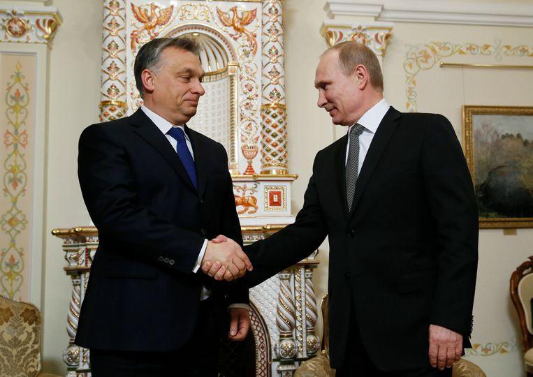 De Hongaarse premier Viktor Orban en de Russische president Vladimir Poetin, hier tijdens een ontmoeting in 2014. Beeld AFP