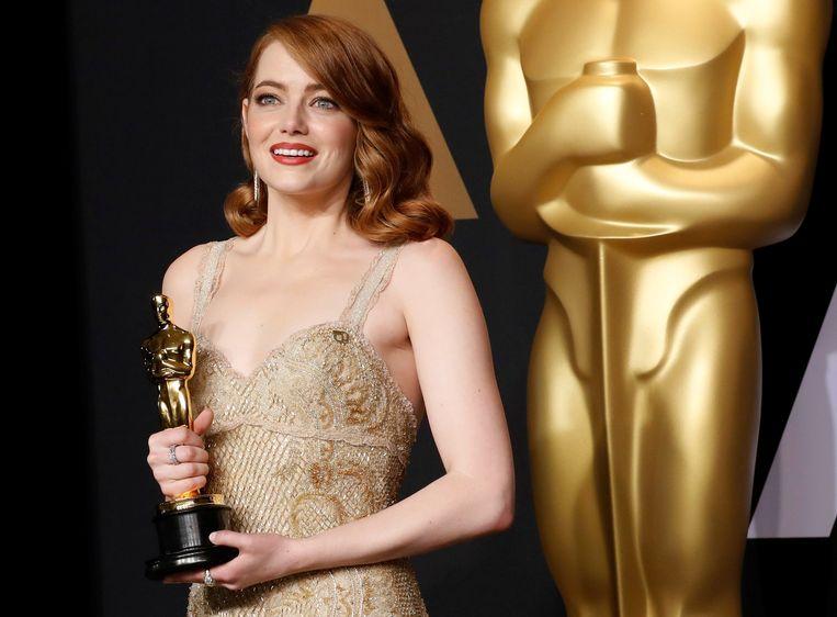 Emma Stone kreeg een Oscar voor haar rol in musical La La Land. Ze mag zich ook de best betaalde actrice van het afgelopen jaar noemen. Beeld REUTERS