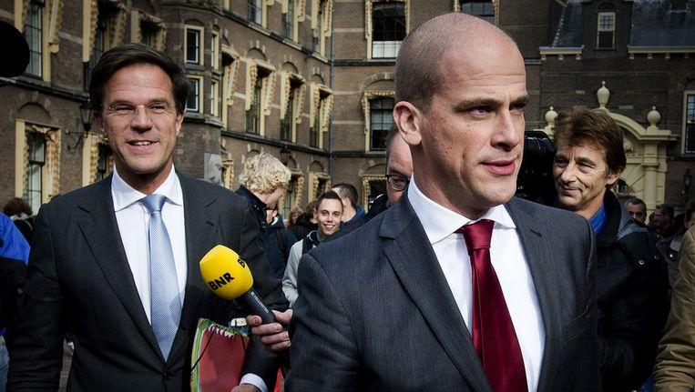 Mark Rutte en Diederik Samsom bij aankomst Binnehof. Beeld ANP