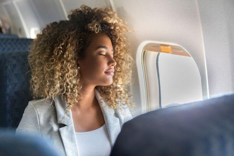 commercial-airline-passenger-sleeps-in-window-seat.jpg