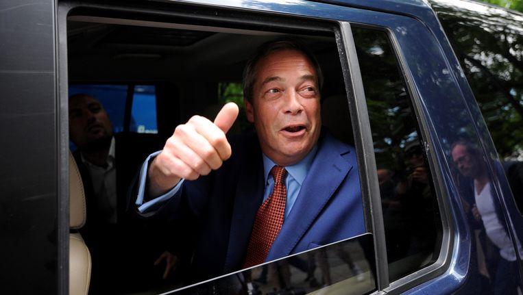 Nigel Farage viert overwinning Brexit-kamp. Beeld getty