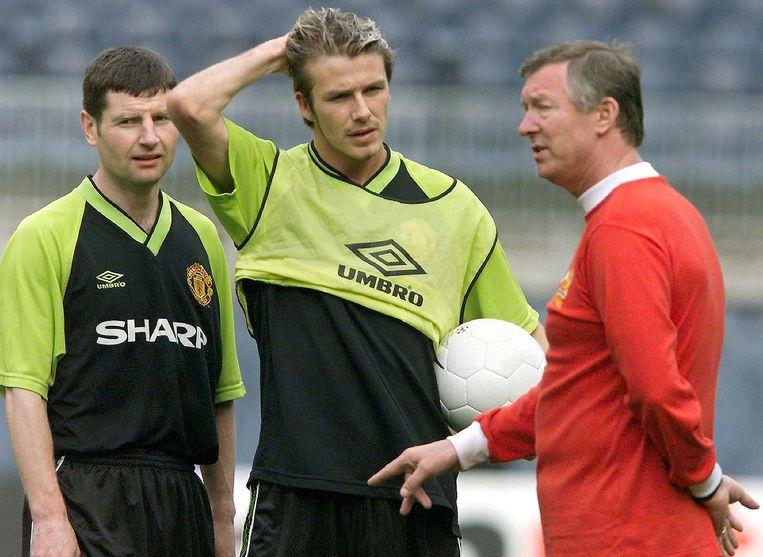 ManU-coach Alex Ferguson praat met David Beckham, 1999. Beeld AFP