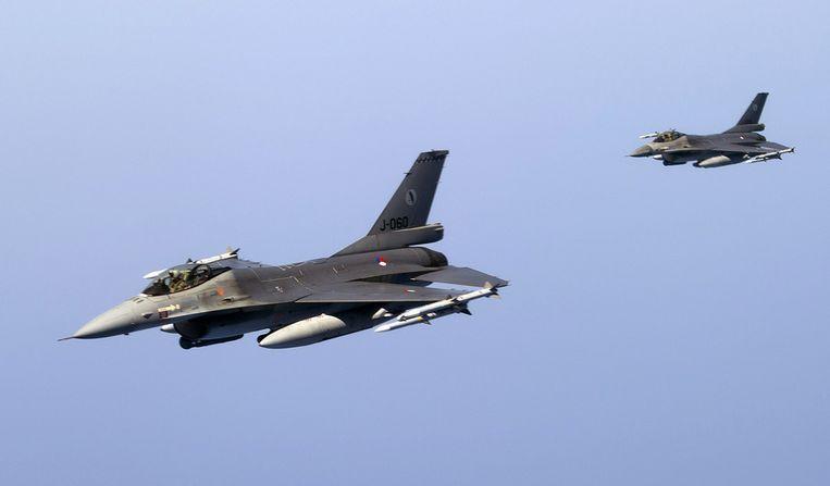 Nederlandse F-16's boven Libië. © ANP Beeld null