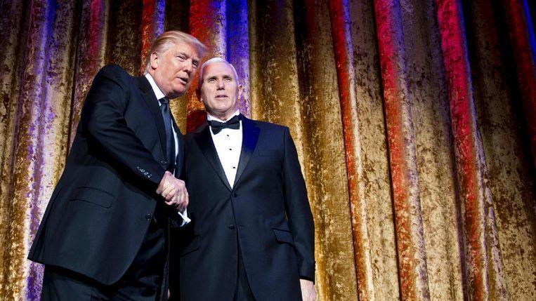 Trump en running mate Pence op een diner dinsdag in Washington.  Beeld AFP