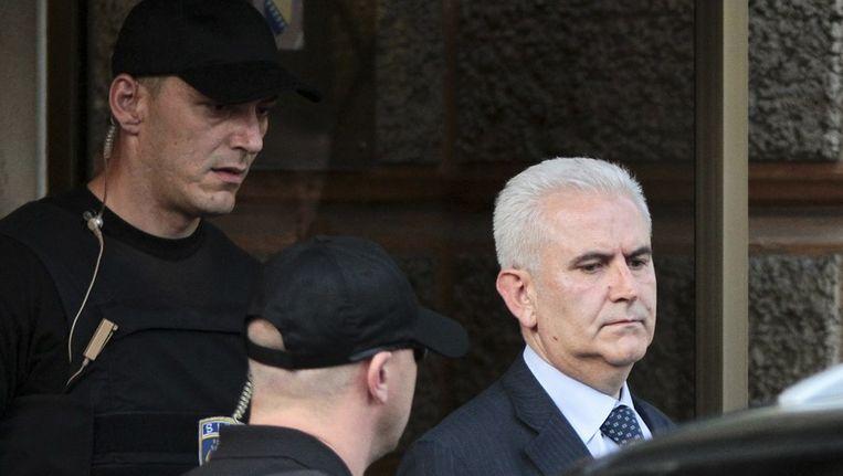 Zivko Budimir bij zijn arrestatie op 26 april in Sarajevo. Beeld REUTERS