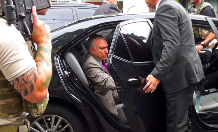 Temer werd gearresteerd in dezelfde corruptiezaak waarvoor voormalig president Lula in de cel zit. Beeld AFP