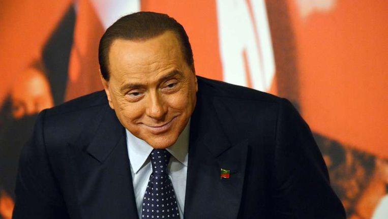 Oud-primier Silvio Berlusconi beschuldigt links van een staatsgreep. Beeld afp