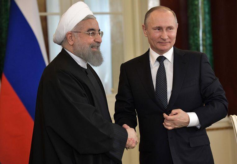 Poetin met de Iraanse president Hassan Rouhani. Beeld EPA