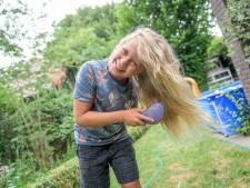 Bas (10) uit Borne knipt zijn superlange haar voor kinderen met kanker