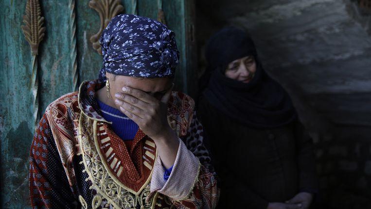 Familie van de geëxecuteerde Egyptenaren rouwt. Beeld ap