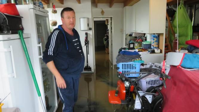 Molenbeek kan regen niet slikken aan Kaperij, woning en straat lopen opnieuw onder water
