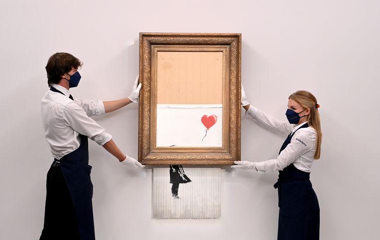 'Love is in the Bin' van Banksy. Beeld EPA
