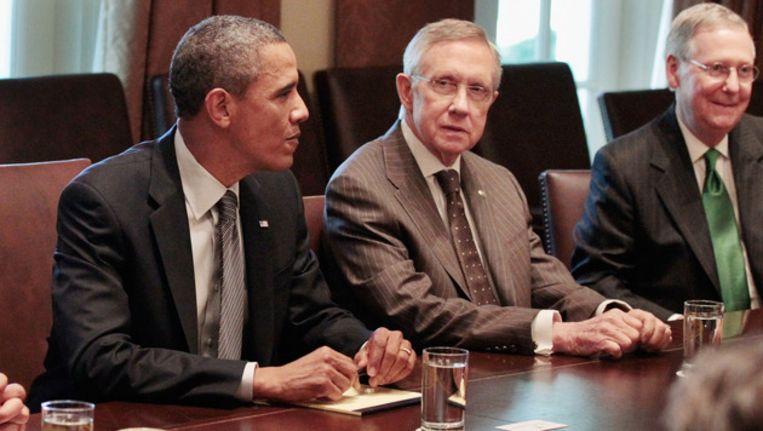 Obama met Harry Reid en Mitch McConnel. Beeld getty