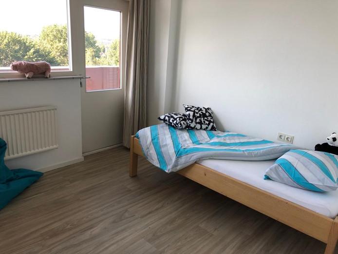 Een slaapkamer in het Prokino Logeerhuis.
