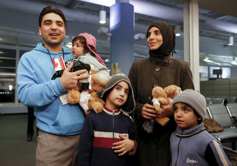 Archiefbeeld: een Syrische familie die net aangekomen is in Canada. Beeld REUTERS