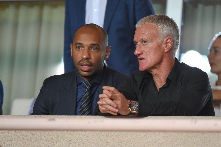 Thierry Henry (links) vroeg raad aan oud-ploegmaat en succescoach Didier Deschamps voor zijn beslissing. Beeld Photo News
