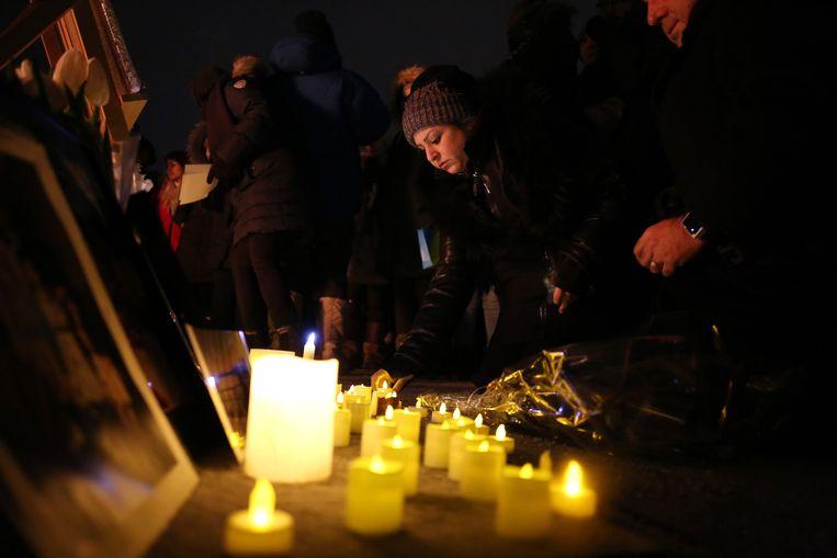 Een wake voor de slachtoffers van de vliegtuigcrash in Ottawa, Canada. Beeld AFP