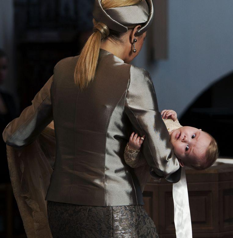 In de armen van moeder Maxima, tijdens de doop in de Kloosterkerk in Den Haag, oktober 2007. Beeld anp