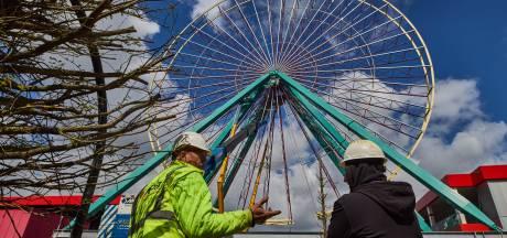 Reuzenrad attractiepark wurmt zich in skyline stad, maar onzekerheid over opening