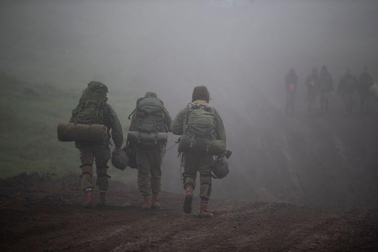 Israëlische soldaten arriveren op de Golanhoogte op de grens tussen Israël en Syrië, 1 maart 2021. Beeld EPA
