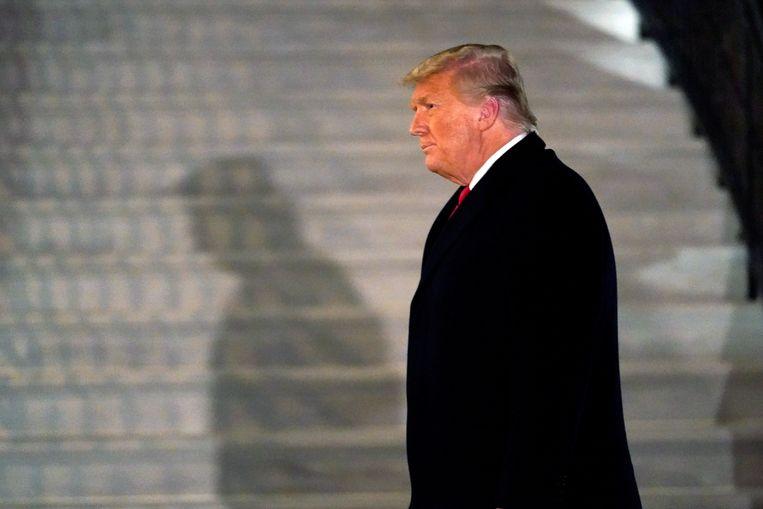 Donald Trump eerder deze week in de tuin van het Witte Huis. Beeld AP