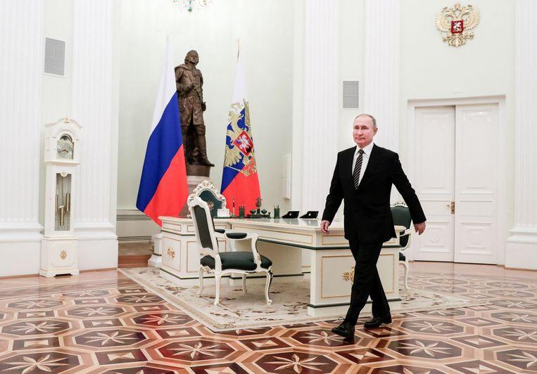 Vladimir Poetin in het Kremlin. 'Het is heel goed denkbaar dat verwarring zaaien in Tsjechië in 2014, op het moment van de schermutselingen in Oekraïne, een politiek doel was', zegt Hubert Smeets.  Beeld AFP